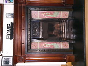 Cast iron fire place with surround and grate