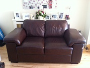 Brown leather 2 seater sofa for sale.